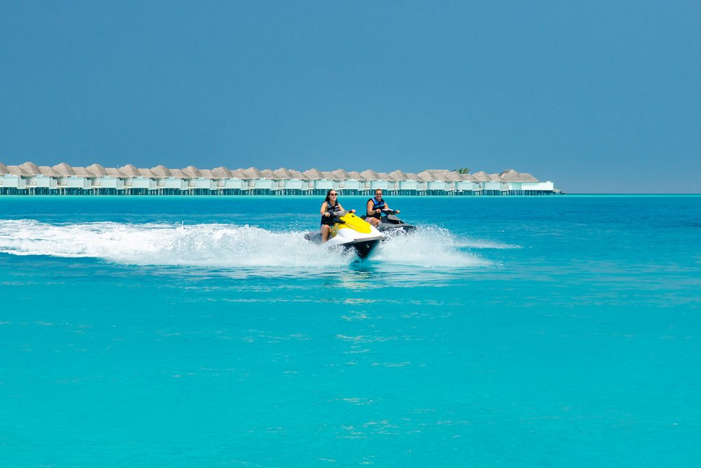 Driving jet ski at Finolhu
