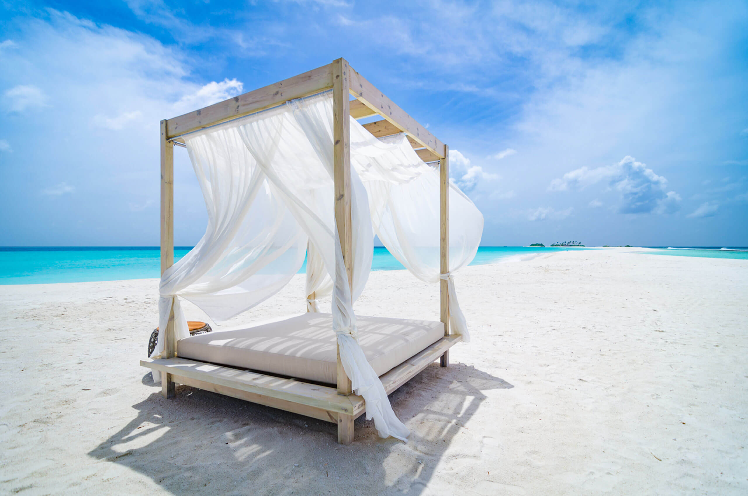 four-poster bed on the sandbank