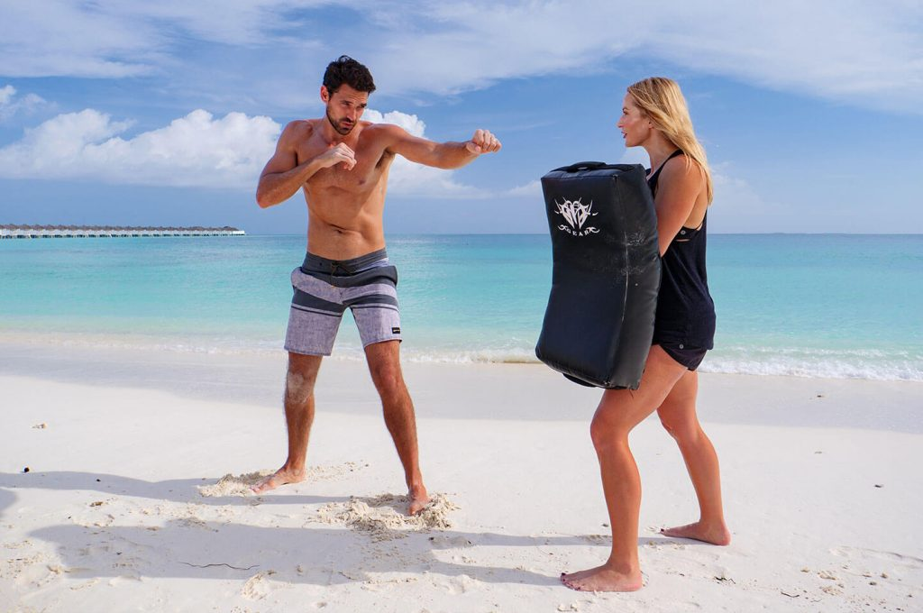 Personal training on the beach at Finolhu