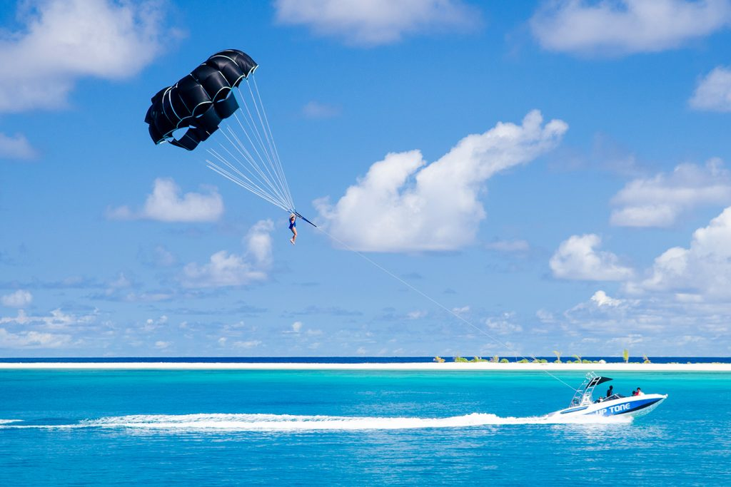 Parasailing watersports at Finolhu