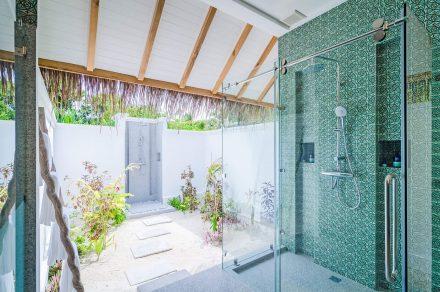 Luxurious bathroom with outdoor rain shower
