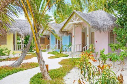 pastel-coloured treatment huts
