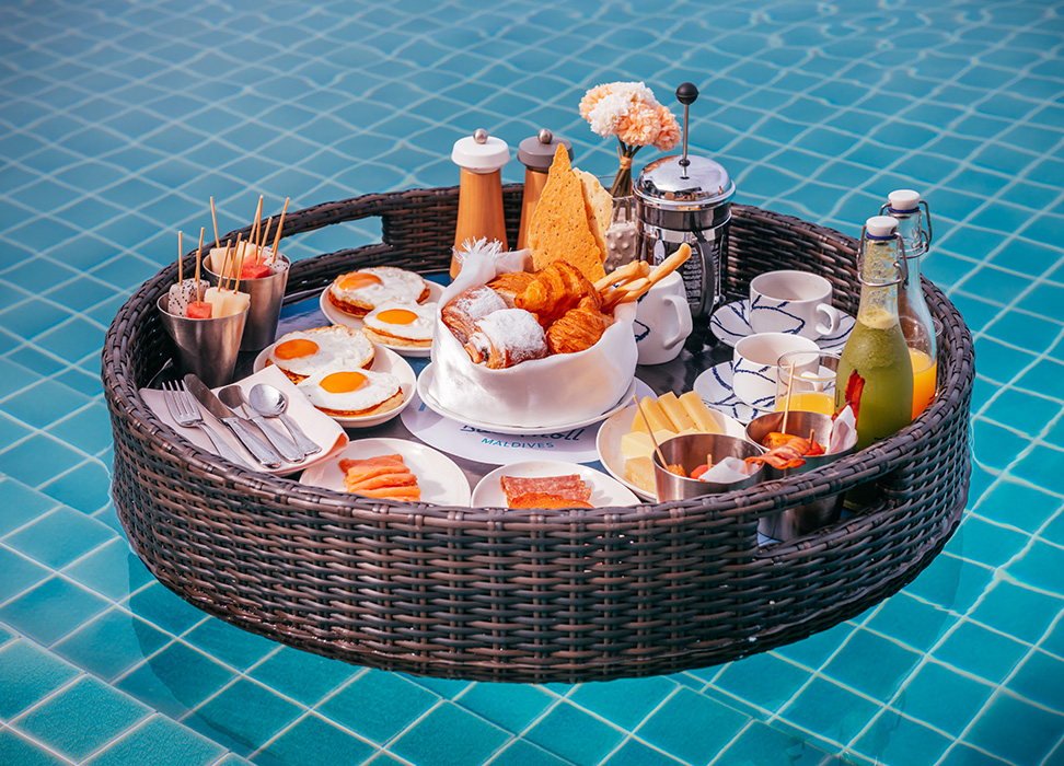 a floating tray with royal breakfast