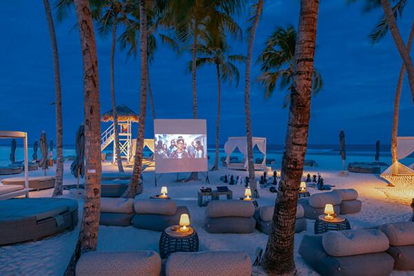 Outdoor cinema at a palm beach on luxury Resort Finolhu