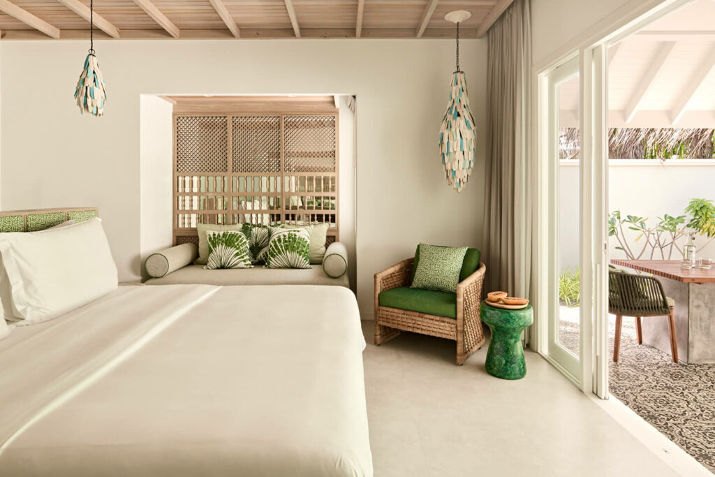 Luxurious bedroom in the Beach Villa with beige and green colour accents and garden view